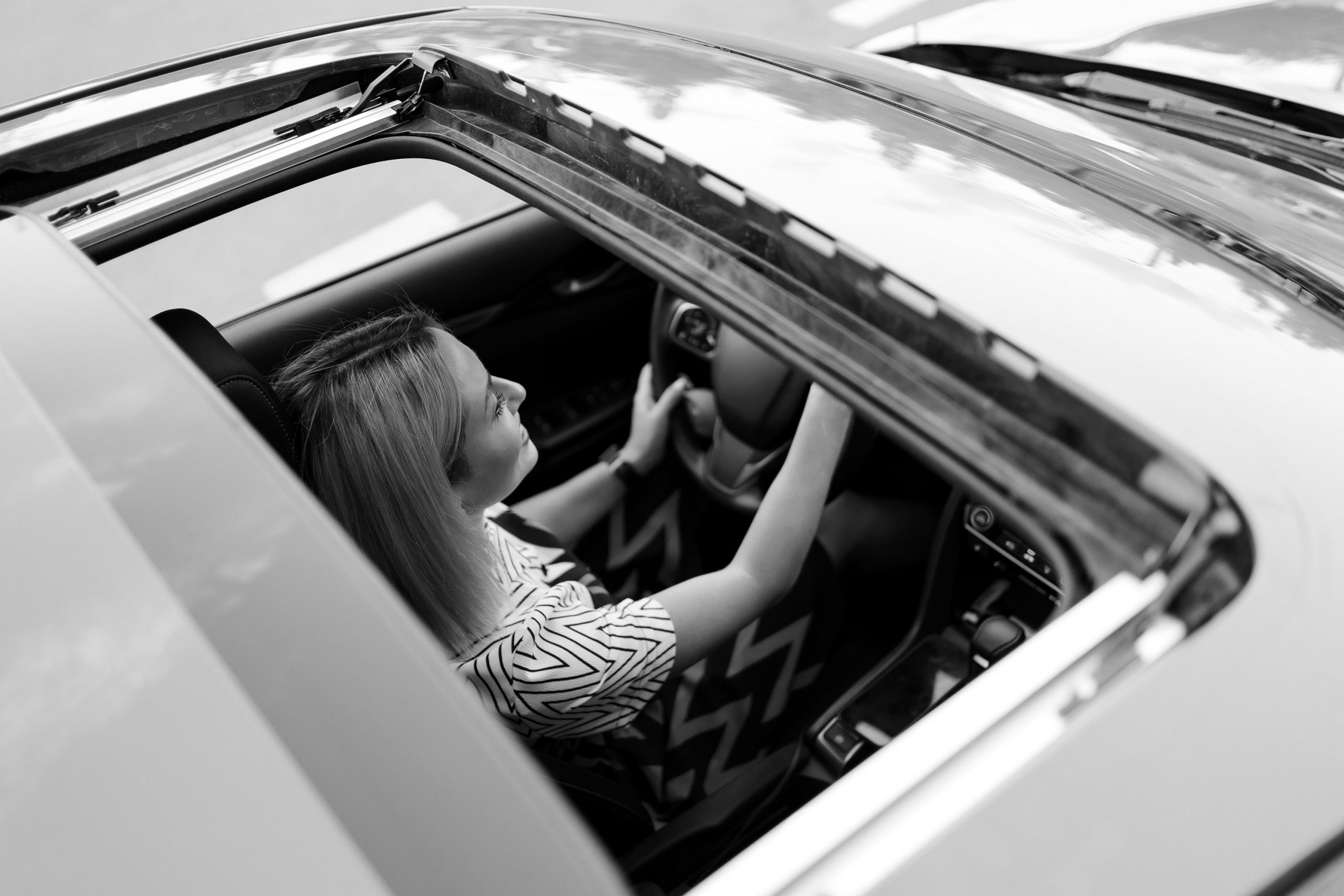 view-of-driving-woman-through-sunroof
